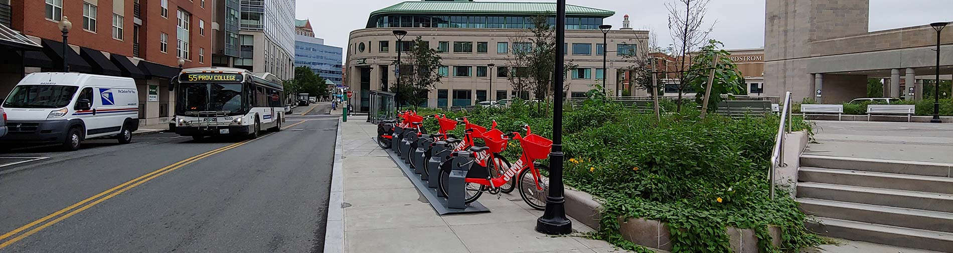 Bike-share site, on a bus route in downtown Providence half-filled with bicycles.